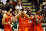 The Virginia Tech bench reacts to their team making a three-point basket against Michigan State during the second half of an NCAA college basketball game Monday, Nov. 25, 2019, in Lahaina, Hawaii. (AP Photo/Marco Garcia)