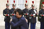 French President Emmanuel Macron, left, hugs Japan's Prime Minister Shinzo Abe before their talks at the Elysee Palace, Tuesday, April 23, 2019 in Paris. (AP Photo/Thibault Camus)