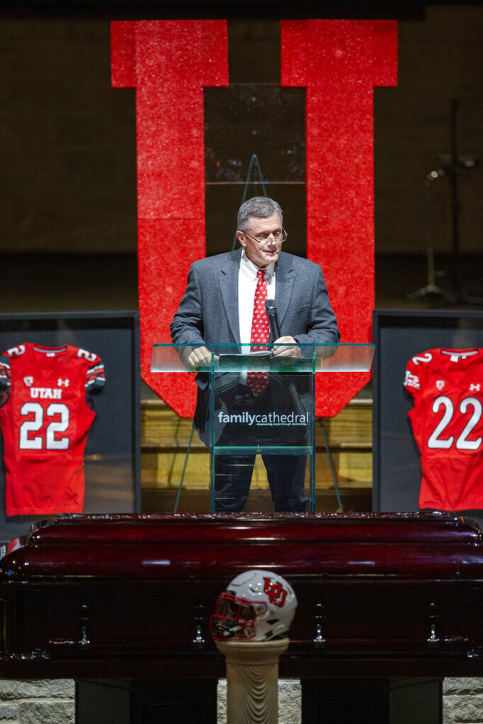 Utah head football coach Kyle Whittingham memorializes Aaron Lowe during a funeral service at Family Cathedral of Praise, Monday, Oct. 11, 2021, in Mesquite, Texas. Lowe, a student and football player at the University of Utah, was was shot and killed on Sept. 26 at a post-game party. (AP Photo/Brandon Wade)