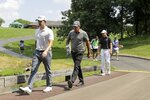 Patrick Cantlay, Phil Mickelson and Jordan Spieth walk to the 10th hole during opening round of the Workday Charity Open golf tournament, Thursday, July 9, 2020, in Dublin, Ohio. (AP Photo/Darron Cummings)
