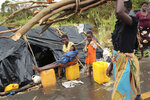 Survivors of Cyclone Idai in a makeshift shelter by the roadside near Nhamatanda about 50 kilometres from Beira, in Mozambique, Friday March, 22, 2019. As flood waters began to recede in parts of Mozambique on Friday, fears rose that the death toll could soar as bodies are revealed. (AP Photo/Tsvangirayi Mukwazhi)
