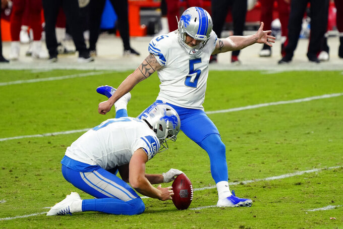Detroit Lions kicker Matt Prater (5) kicks the game winning field goal as punter Jack Fox (3) holds during the second half of an NFL football game against the Arizona Cardinals, Sunday, Sept. 27, 2020, in Glendale, Ariz. The Lions won 26-23. (AP Photo/Rick Scuteri)