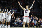 Gonzaga's Corey Kispert (24) celebrates after a teammate scored a 3-point shot against Saint Mary's in the first half of an NCAA college basketball game in the final of the West Coast Conference men's tournament Tuesday, March 10, 2020, in Las Vegas. (AP Photo/John Locher)
