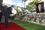 U.S. Health and Human Services Secretary Alex Azar places flowers at a memorial for former Taiwanese President Lee Teng-hui in Taipei, Taiwan, Wednesday, Aug. 12, 2020. Wednesday is the last day of Azar's schedule during the highest-level visit by an American Cabinet official since the break in formal diplomatic ties between Washington and Taipei in 1979. (Wang Teng-yi/Pool Photo via AP)