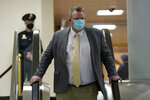 Sen. Jon Tester, D-Mont., walks on Capitol Hill in Washington, Thursday, Feb. 11, 2021, after the conclusion of the third day of the second impeachment trial of former President Donald Trump. (AP Photo/Susan Walsh)