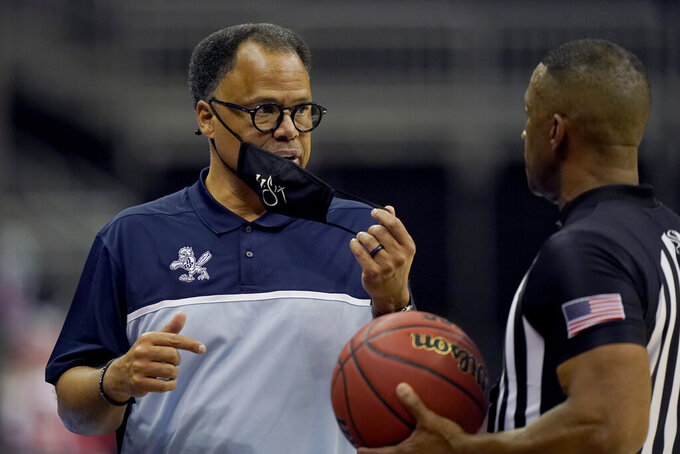 Liberty head coach Ritchie McKay, left, talks to an official during the second half of an NCAA college basketball game against South Carolina, Saturday, Nov. 28, 2020, in Kansas City, Mo. (AP Photo/Charlie Riedel)