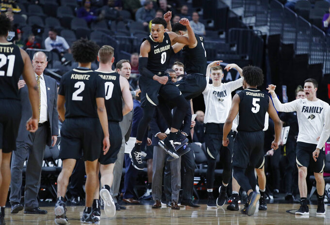 Colorado's Shane Gatling (0) and Tyler Bey (1) celebrate after a play against Oregon State during the first half of an NCAA college basketball game in the quarterfinal round of the Pac-12 men's tournament Thursday, March 14, 2019, in Las Vegas. (AP Photo/John Locher)