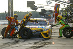 Kyle Busch makes a pit stop during the NASCAR Cup Series auto race at Pocono Raceway, Sunday, June 28, 2020, in Long Pond, Pa. (AP Photo/Matt Slocum)