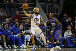 Golden State Warriors guard Ky Bowman, left, passes the ball over Charlotte Hornets guard Terry Rozier during the first half of an NBA basketball game in Charlotte, N.C., Wednesday, Dec. 4, 2019. (AP Photo/Nell Redmond)