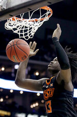 Oklahoma State's Isaac Likekele watches the ball after his dunk during the first half of the team's NCAA college basketball game against TCU in the Big 12 men's tournament Wednesday, March 13, 2019, in Kansas City, Mo. (AP Photo/Charlie Riedel)