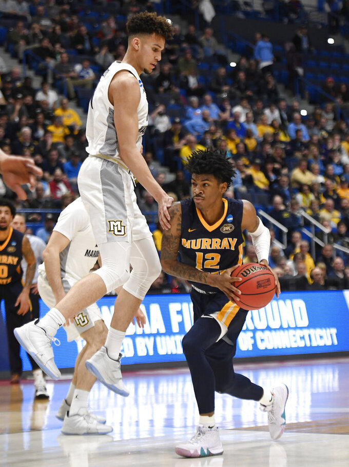 Murray State's Ja Morant (12) drives around Marquette's Brendan Bailey during the second half of a first-round game in the NCAA men's college basketball tournament Thursday, March 21, 2019, in Hartford, Conn. (AP Photo/Jessica Hill)