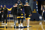 Iowa forward Jack Nunge is helped off the court during the first half of an NCAA college basketball game against Michigan, Thursday, Feb. 25, 2021, in Ann Arbor, Mich. (AP Photo/Carlos Osorio)