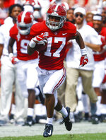 FILE - In this Sept. 29, 2018, file photo, Alabama wide receiver Jaylen Waddle (17) catches pass against Louisiana-Lafayette for a touchdown during the second half of an NCAA college football game, in Tuscaloosa, Ala. No. 1 Alabama has one of the SEC's most talented collection of receivers, and the Crimson Tide is spreading it around among Jerry Jeudy, Henry Ruggs III, DeVonta Smith and Jaylen Waddle. (AP Photo/Butch Dill, File)
