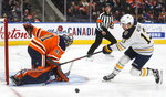 Buffalo Sabres' Jimmy Vesey (13) is stopped by Edmonton Oilers' goalie Mike Smith (41) during the third period of an NHL hockey game, Sunday, Dec. 8, 2019 in Edmonton, Alberta. (Jason Franson/The Canadian Press via AP)