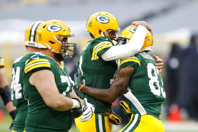 Green Bay Packers' Marquez Valdes-Scantling is congratulated by quarterback Aaron Rodgers after catching a touchdown pass during the first half of an NFL football game against the Jacksonville Jaguars Sunday, Nov. 15, 2020, in Green Bay, Wis. (AP Photo/Matt Ludtke)