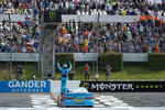 Kyle Busch celebrates after winning a NASCAR Cup Series auto race at Pocono Raceway, Sunday, June 2, 2019, in Long Pond, Pa. (AP Photo/Matt Slocum)