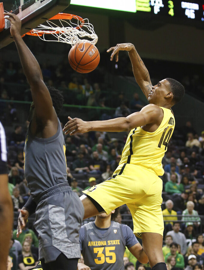 Oregon's Kenny Wooten, right, dunks over Arizona State's Luguentz Dort during the second half of an NCAA college basketball game Thursday, Feb. 28, 2019, in Eugene, Ore. (AP Photo/Chris Pietsch)