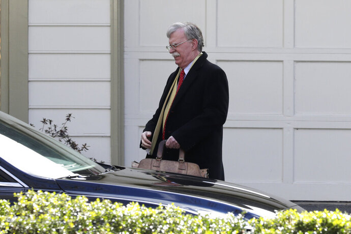 Former National security adviser John Bolton leaves his home in Bethesda, Md., Tuesday, Jan. 28, 2020. President Donald Trump's legal team is raising a broad-based attack on the impeachment case against him even as it mostly brushes past allegations in a new book that could undercut a key defense argument at the Senate trial. Former national security adviser John Bolton writes in a manuscript that Trump wanted to withhold military aid from Ukraine until it committed to helping with investigations into Democratic rival Joe Biden. (AP Photo/Luis M. Alvarez)