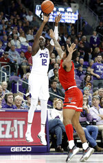 TCU forward Kouat Noi (12) shoots a 3-point basket over Texas Tech forward Deshawn Corprew (3) in the second half of an NCAA college basketball game in Fort Worth, Texas, Saturday, March 2, 2019. (AP Photo/Tony Gutierrez)