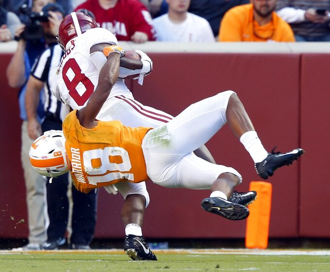 Alabama running back Josh Jacobs (8) is tackled from behind by Tennessee defensive back Nigel Warrior (18) in the first half of an NCAA college football game Saturday, Oct. 20, 2018, in Knoxville, Tenn. (AP Photo/Wade Payne)