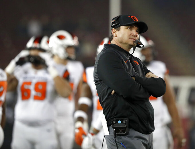 Oregon State head coach Jonathan Smith looks at the scoreboard during a timeout against Stanford in the second half during an NCAA college football game on Saturday, Nov. 10, 2018, in Stanford, Calif. (AP Photo/Tony Avelar)
