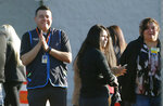 Walmart employees gather outside the Walmart store for a reopening event, Thursday, Nov. 14, 2019 in El Paso, Texas.  Customers returned to the store that been closed since August when a gunman opened fire at the store and killed 22 people.  (Briana Sanchez/The El Paso Times via AP)