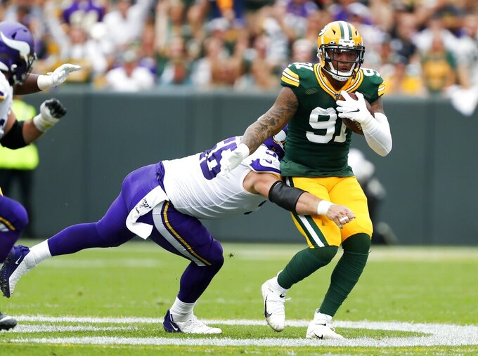 Green Bay Packers' Preston Smith intercepts a pass during the first half of an NFL football game against the Minnesota Vikings Sunday, Sept. 15, 2019, in Green Bay, Wis. (AP Photo/Matt Ludtke)