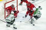 Carolina Hurricanes goaltender Petr Mrazek watches the puck while Hurricanes defenseman Brady Skjei (76) defends against Dallas Stars right wing Denis Gurianov (34) and center Justin Dowling (37) during the third period of an NHL hockey game in Raleigh, N.C., Sunday, April 4, 2021. (AP Photo/Gerry Broome)