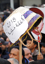 A demonstrator holds a basket with the placard