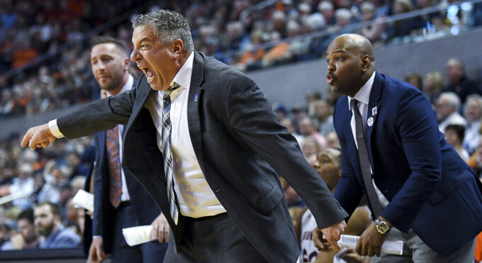 Auburn head coach Bruce Pearl reacts to a play on the sidelines during the first half of an NCAA college basketball game against Iowa State Saturday, Jan. 25, 2020, in Auburn, Ala. (AP Photo/Julie Bennett)