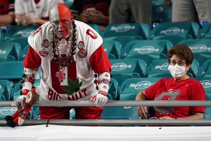Ohio State fans watch during warm ups before an NCAA College Football Playoff national championship game against Alabama Monday, Jan. 11, 2021, in Miami Gardens, Fla. (AP Photo/Lynne Sladky)