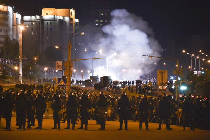 Police block a road and use smoke grenades during a protest after the Belarusian presidential election in Minsk, Belarus, Sunday, Aug. 9, 2020. Belarus police and protesters clashed in the capital and the city of Brest Sunday night after a presidential election in which the country's longtime leader sought a sixth term despite rising discontent with his authoritarian rule and his cavalier dismissal of the coronavirus pandemic. (AP Photo)