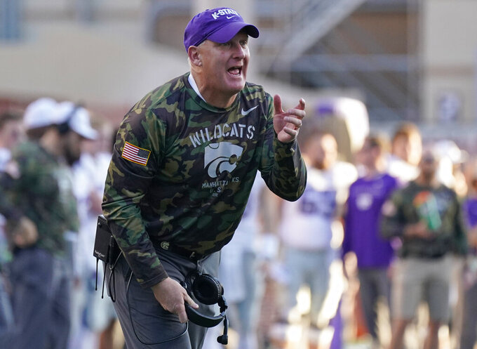 Kansas State head coach Chris Klieman argues a call during the second half of an NCAA college football game against Texas in Austin, Texas, Saturday, Nov. 9, 2019. (AP Photo/Chuck Burton)