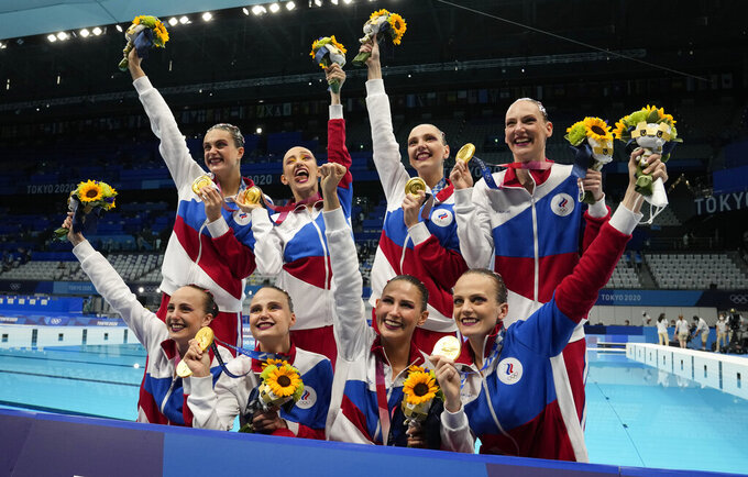 Team of Russian Olympic Committee pose with their gold medals after artistic swimming team free routine competition at the 2020 Summer Olympics, Saturday, Aug. 7, 2021, in Tokyo, Japan. (AP Photo/Dmitri Lovetsky)