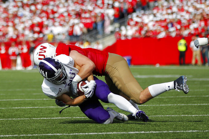 Wisconsin defensive end Michael Balistreri (57) takes down Northwestern running back Drake Anderson (6) during the second half of an NCAA college football game Saturday, Sept. 28, 2019, in Madison, Wis. Wisconsin won 24-15. (AP Photo/Andy Manis)