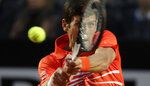 Novak Djokovic of Serbia returns the ball to Diego Schwartzman of Argentina during a semifinal match at the Italian Open tennis tournament, in Rome, Saturday, May 18, 2019. (AP Photo/Andrew Medichini)