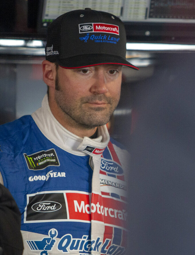 Paul Menard in the garage area during practice for the NASCAR Monster Energy Cup Series race at Martinsville Speedway in Martinsville, Va., Saturday, March 23, 2019. (AP Photo/Matt Bell)