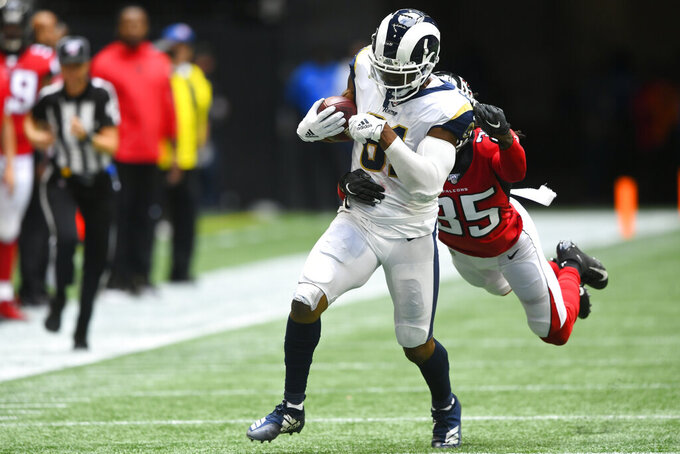 Los Angeles Rams tight end Gerald Everett (81) runs against Atlanta Falcons defensive back Jamal Carter (35) during the second half of an NFL football game, Sunday, Oct. 20, 2019, in Atlanta. (AP Photo/John Amis)