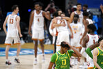 Oregon forward Chandler Lawson (13) walks off the court after a Sweet 16 game against Southern California in the NCAA men's college basketball tournament at Bankers Life Fieldhouse, Sunday, March 28, 2021, in Indianapolis. Southern California won 82-68. (AP Photo/Jeff Roberson)