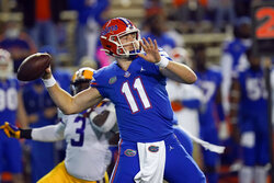 Florida quarterback Kyle Trask (11) throws a pass as LSU linebacker Andre Anthony (3) rushes during the first half of an NCAA college football game Saturday, Dec. 12, 2020, in Gainesville, Fla. (AP Photo/John Raoux)