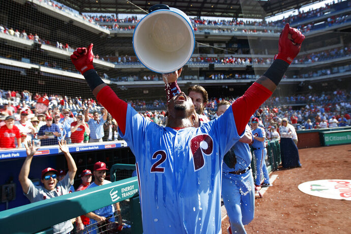 Philadelphia Phillies' Jean Segura, front, celebrates after being doused by Bryce Harper after Segura hit a game-winning three-run home run off New York Mets relief pitcher Edwin Diaz during the ninth inning of a baseball game, Thursday, June 27, 2019, in Philadelphia. Philadelphia won 6-3. (AP Photo/Matt Slocum)