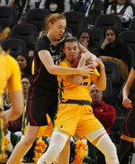 Stanford's Ashten Prechtel, behind, and San Francisco's Julia Nielacna struggle for the ball during the first half of an NCAA college basketball game, Saturday, Nov. 9, 2019, in San Francisco. (AP Photo/George Nikitin)