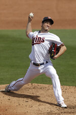 Minnesota Twins starting pitcher Kenta Maeda works in the second inning of a spring training baseball game against the Boston Red Sox Monday, Feb. 24, 2020, in Fort Myers, Fla. (AP Photo/John Bazemore)