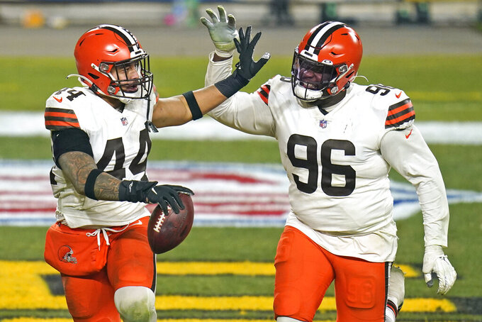 Cleveland Browns outside linebacker Sione Takitaki (44) celebrates with Vincent Taylor after intercepting a pass by Pittsburgh Steelers quarterback Ben Roethlisberger (7) during the second half of an NFL wild-card playoff football game, Sunday, Jan. 10, 2021, in Pittsburgh. (AP Photo/Keith Srakocic)