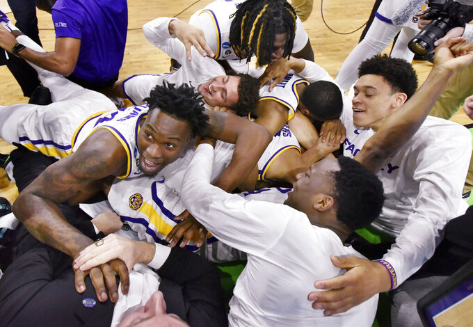 LSU players celebrate their 69-67 win over Maryland in a second-round game in the NCAA men's college basketball tournament in Jacksonville, Fla., Saturday, March 23, 2019. (Will Dickey/The Florida Times-Union via AP)