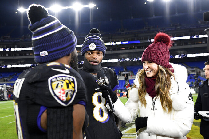 Baltimore Ravens running back Mark Ingram, left, pretends to interview quarterback Lamar Jackson (8) while standing with Fox sideline reporter Erin Andrews after an NFL football game against the New York Jets, Thursday, Dec. 12, 2019, in Baltimore. The Ravens won 42-21. (AP Photo/Nick Wass)
