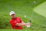 Ian Poulter, of England, hits from a bunker on the 16th hole during the second round of the Workday Charity Open golf tournament, Friday, July 10, 2020, in Dublin, Ohio. (AP Photo/Darron Cummings)