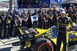 Colton Herta poses with his Andretti Autosport team after winning the pole, Saturday, Sept. 18, 2021, at Laguna Seca Raceway in Monterey, Calif. Herta is the defending race winner from 2019. (AP Photo/Jenna Fryer)