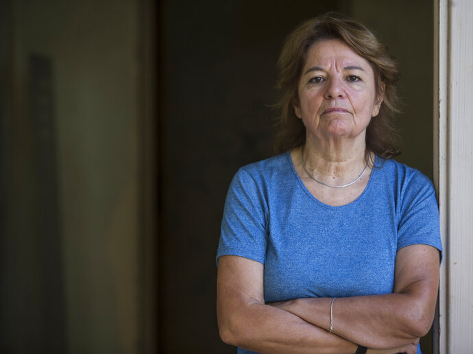 Graciela Garcia, who was turned into a sex slave when she was in her 20's by a former navy captain during Argentina's 1976-1983 dictatorship, poses for a portrait inside what was once the Naval Mechanics School, ESMA, where she was jailed, as she attends the inauguration of an exhibit at the detention center, now a museum, in Buenos Aires, Argentina, Thursday, March 14, 2019. Garcia's testimony is part of a new exhibit where 28 women recount harrowing stories of dictatorship-era gender-based violence. (AP Photo/Daniel Jayo)