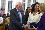 Democratic presidential candidates US. Sen. Bernie Sanders, left, I-Vt. and Sen. Elizabeth Warren, right, D-Mass., shake hands as U.S. Rep. Tulsi Gabbard, center, D-Hawaii, watches at a Martin Luther King Jr. Day services at Zion Baptist Church, Monday, Jan. 20, 2020, in Columbia, S.C. (AP Photo/Meg Kinnard)